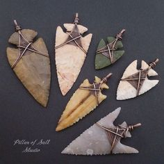 These arrowheads were sent to me by a customer to have wrapped into pendants. A fun collection of shapes and colors! #arrowhead #wirewrappedjewelry #pillarofsaltstudio