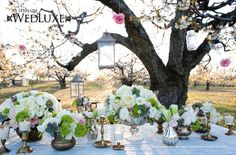 flowery tablescape from WedLuxe Magazine