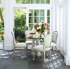 Designer Trish Sarnataro used this glass-top breakfast table to reflect the great outdoors. Photo: Werner Straube.  I love this idea and put a beautiful Rod Iron glass table and chairs on my patio and then to the side a outdoor couch coffee table chairs ottomans and outdoor fireplace with rug. Here is So Cal it extends our living space and is wonderful to sit at anytime of day and enjoy nature.