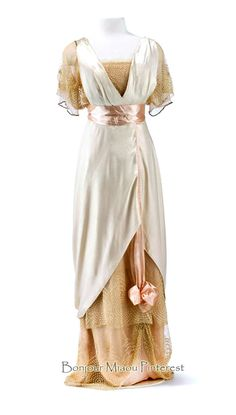 Evening dress, Jean-Philippe Worth, ca. 1912. Silk satin and silk voile in cream, pink and rose, trimmed with glass, metal, and beige machine lace. High waist. Photo: Stephan Klonk. Museum of Decorative Arts, Berlin, via Europeana Fashion