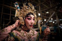 Cantonese opera: An actress adjusts her hat