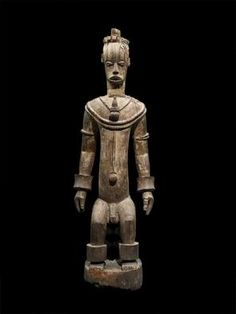 Houston Museum. The Urhobo live in southern Nigeria, on the western edge of the Niger River delta. Their most important cult is dedicated to ancestors who are represented as mythical warriors of powerful spirits. The fierce attitude and commanding physique of this warrior exemplify the Urhobo view that these beings are capable of protecting the community from attack and evil spirits. This monumental sculpture is exceptional , state of preservation, and fearsome guardians...