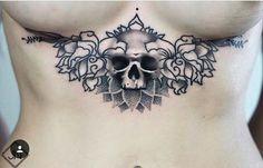 Skull underboobs tattoo