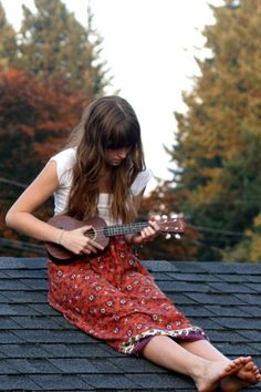 I want to be this girl: pretty dress, flowing locks, sittin' on the roof…