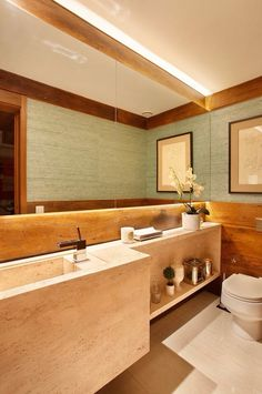Lavabo com cuba esculpida por Paola Ribeiro #interiordesign #bathroom #homedecor…