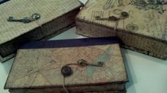 up-cycled book boxes made from old photo albums or book covers. DIY. Maps, script, mod podge, decoupage, craft paper, keys, twine, buttons. Organize and hide clutter.