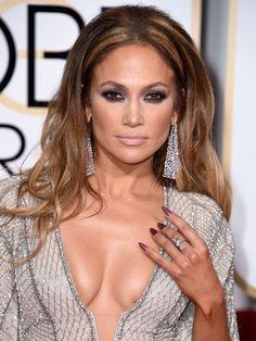 Jennifer Lopez wearing Lorraine Schwartz diamond chandelier earrings and a three-stone statement diamond ring to the 72nd Annual Golden Globes