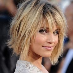 how do I get this texture?Ask your stylist to cut your hair with a feather razor. It doesn't make your ends blunt and it gives it the texture you're looking for :)