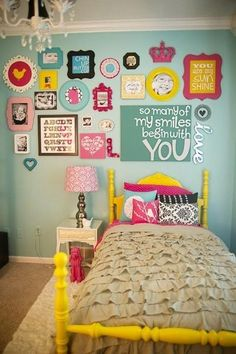Love this bright frame wall and the yellow bed!