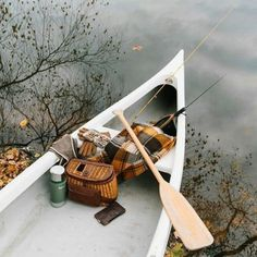 Canoe on the lake with blanket, picnic an hot coffee. Outdoors in the fall.