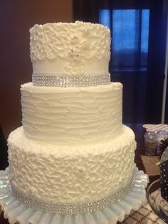 All white elegant rustic wedding cake with some bling!