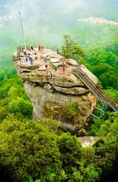Chimney Rock, North Carolina I want to go back. It was so awesome to stand on chimney Rock Places Around The World, Oh The Places You'll Go, Places To Travel, Around The Worlds, Cool Places To Visit, Chimney Rock North Carolina, Sliding Rock North Carolina, Adventure Is Out There, Vacation Spots