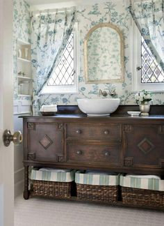 Bathroom vanity- love the mission style and the colors and baskets