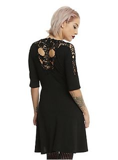 """<p>This casual LBD will geta little more attention when you turn around!Black cotton skater dress has a scoop neck and half sleeves with crocheted detailed shoulders and a skull crocheted back. We provide the dress, you provide the attitude!</p><ul><li>87% polyester; 10% rayon; 3% spandex</li><li>Wash cold; dry low</li><li>Approx. 33"""" from shoulder to hem</li><li>Model is wearing size small</li><li>Made in USA</li></ul>"""