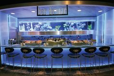 "City Market, Mexico City.  The ""Bar Do Mar"" uses special lighting effects and a saltwater living aquarium help create the perfect atmosphere for thier seafood diners."