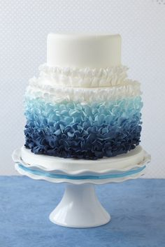 hey what a beautiful cake i cant imagine making each one of the petals for that cake