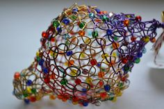 Colorful Hand Knitted Wire Christmas Ornament. $25.00, via Etsy.