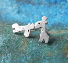 Really tiny giraffe studs in sterling silver on Etsy, $18.00