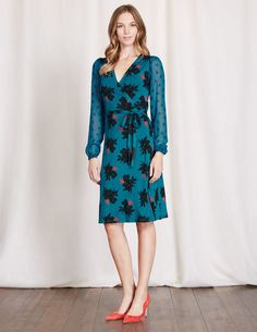 May we present your new go-to wrap dress. Sheer feminine sleeves with gathered cuffs are ingeniously paired with a low V-neck to create this little masterpiece. We're not promising anything, but you may feel (and look) like a Grecian Goddess.