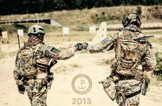 Polish JWK operators brofist after training