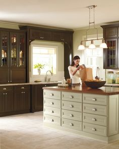 Turkey Hill from Martha Stewart Living keeps the same the Federal style seen in Martha's home. Glass-paneled cabinetry and fluted fillers help its richness and color. We designed our cabinetry to coordinate, so it's easy to play with color. Try using a darker tone for your cabinets, and a lighter, more neutral color for your kitchen island. Shop Martha Stewart Living at the The Home Depot.