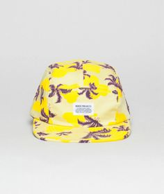 Hat's off to Eric Parker and Norse Projects for designing this super cool and casual five panel cap. Bright yellow with dark purple palms, this head topper is the go-to accessory for noggins everywhere. Wear it straight, wear it sideways, wear it backwards—any way you wear it you'll be chillin' in the shade.