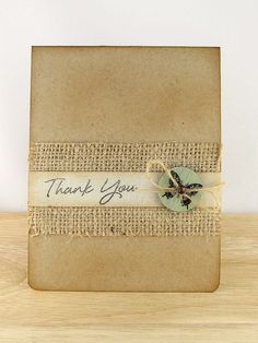 I love the texture of this handmade thank you card, with an inked kraft base and a swatch of burlap.  A wooden button has been added with some twine and a simple sentiment are all you need for this simple message.