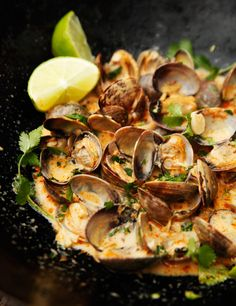 Thai inspired steamed clams in a red curry, coconut, ginger, and garlic infused broth. This dish is amazing and so easy!