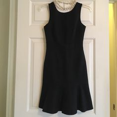 Flouncy black Banana Republic Dress Black dress from Banana Republic with fun, floaty, flouncy hem. The back has a V in the back instead of the traditional scoop neck, makes for an elegant twist on the usual :)    Love this dress! So sad it no longer fits me ☹️                                                               Perfect for work. Classic and sophisticated! Looks amazing with heels and pearls (my favorite!) Banana Republic Dresses Midi