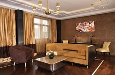 Modern living room design, comfortable sofa, center table, lovely wall painting, hanging light, curtain and tiles flooring  http://www.urbanhomez.com/construction/interior_designer Find Top Architects in Bangalore for your Home & Office at http://www.urbanhomez.com/suppliers/architects/bangalore Find Top Architects in Pune for your Home & Office at http://www.urbanhomez.com/suppliers/architects/pune http://www.urbanhomez.com/suppliers/interior_designer/bangalore