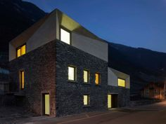 engadin-style windows let maximum natural light in. here, they take advantage of an entire wall. Charrat Transformation by Clavienrossier Contemporary Architecture, Architecture Details, Interior Architecture, Landscape Architecture, Caves, Switzerland House, Villa, Farmhouse Renovation, Corner House