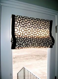 $4 Window Covering - build your own blinds with whatever fabric you want. All you need is scissors & some glue.