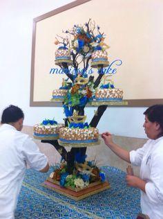 Masquerade quinceañera cake on tree stand. Visit us Facebook.com/marissa'scake or www.elmanjarperuano.com
