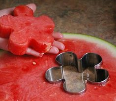 Cutting a watermelon into shapes using cookie cutters. why didn't I think of this? Great idea