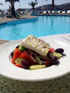 * Delicious Greek salad beside the pool at Farout Beach Hotel in Ios Greece | Sara Russell Interiors