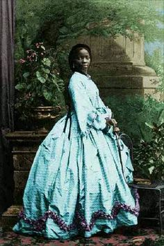 """Lady Sarah Forbes Bonetta Davies was born into a Royal West African Dynasty. She was orphaned in 1848 when her parents were killed in a slave hunting war. She was around 5 years old. In 1850 Sarah was taken to England and presented to Queen Elizabeth as a """"gift"""" from the King of Dahomey. She became the Queen's Goddaughter and a celebrity known for her extraordinary personal intelligence."""