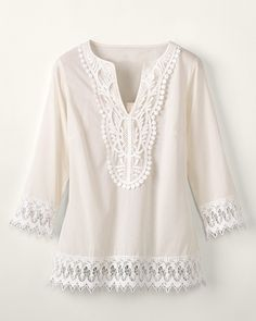 Beige/off-white pullover tunic with lots of delicate embroidered details and lace.