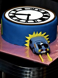 Back To The Future birthday cake for my brother. Time on the clock is exactly 10:04PM. There's also a flux capacitor on the side as well as the arrow from the logo and the Twin Pines Mall logo      Moscovisch cake with homemade buttercream inside and chipolata cream filling. Topping and decorations are all fondant