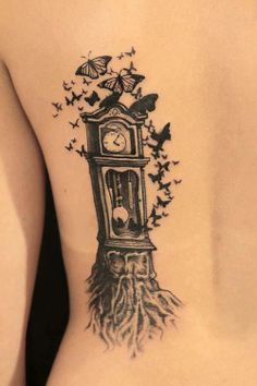 grandfather clock with tree roots and butterflys. Awesome tattoo. #tattoo #tattoos #ink
