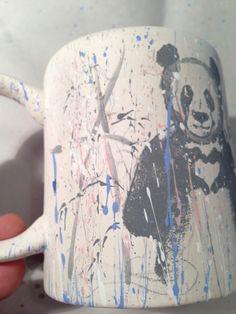unglazed panda on ceramic mug