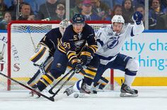 Tampa Bay Lightning at Buffalo Sabres Game W 3-1- 04/14/2013 Mark Pysyk #53 of Buffalo battles for the puck with Tom Pyatt #11 of Tampa Bay in front of teammate Jhonas Enroth #1 at First Niagara Center.  (Photo by Bill Wippert/NHLI via Getty Images)