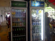 Front of fridge, in front of drinks stall