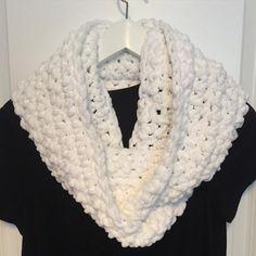 Bright white super soft chunky infinity scarf. I know winter is almost over but this scarf is so soft and warm. #crochet #crochetscarf #crochetaddict #crochetersofinstagram #bulkyscarf #softscarf #madeinmanitoba #madeinwinnipeg #handmademanitoba #handmadewinnipeg #whitescarf #infinityscarf #supersoftscarf #softyarn by crochettibykelly