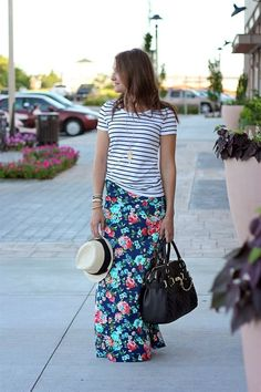 Pairing stripes with a floral is a fabulous way to start pattern mixing. What a dynamic outfit!