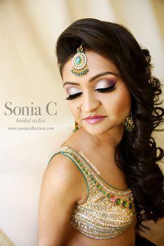indian bridal look! garba makeup, sangeet makeup, reception makeup, curls, hair down, silver and purple shadow, matte shadows, green tikka