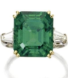 Emerald and diamond ring, Cartier. photo Sothebys The emerald-cut emerald weighing carats, flanked by tapered baguette diamonds weighing approximately carat, mounted in 18 karat gold and platinum,signed Cartier. Cartier Jewelry, Emerald Jewelry, Cartier Gold, Emerald Rings, Ruby Rings, Gemstone Jewelry, Columbian Emeralds, Jewelry Accessories, Jewelry Design