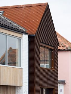 Mole Architects broke up the building into three connected blocks – a white-painted flint and brickwork block and a slimmer Corten-clad volume on the seafront with a grey-painted render volume behind. British Architecture, Residential Architecture, Amazing Architecture, Wells Next The Sea, Two Bedroom House, Building Contractors, House Names, Architectural Features, Brickwork