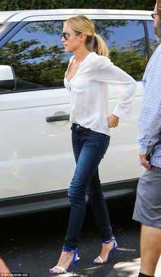 Obsessed right now with the combination skinny jeans and heals. Add a white shirt and sun glasses - perfection-
