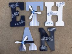 A personal favorite from my Etsy shop https://www.etsy.com/listing/516206904/wooden-airplane-letters-wood-airplane