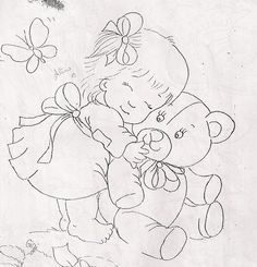 Girl hugging teddy bear